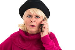 Scared senior woman with cellphone. Stock Image