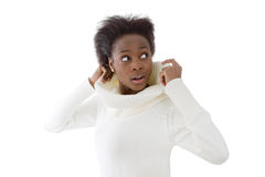 Scared and shocked african american black woman in white sweater Royalty Free Stock Photo