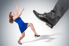 Scared and shocked small business woman under boss pressure stock photo