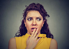 Scared shocked woman  on gray background Stock Image