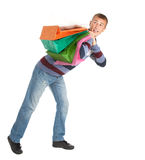 Scared shopping young man with bags Stock Image