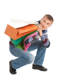 Scared shopping young man with bags Stock Photos
