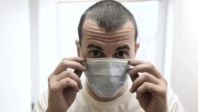 Scared sick man in medical mask. concept pandemic lifestyle virus self-isolation covid 19 infection doomsday. man a