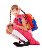 Scared sitting schoolchild  in eyeglasses. Stock Photos