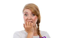 Scared, stressed woman biting her nails Stock Images