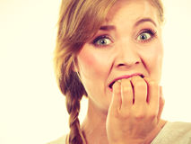 Scared, stressed woman biting her nails Royalty Free Stock Photography