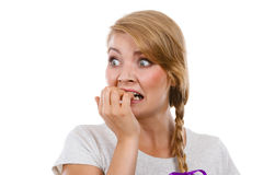 Scared, stressed woman biting her nails Royalty Free Stock Photo