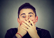 Scared stunned shocked young man. Headshot scared stunned shocked young man Royalty Free Stock Photo