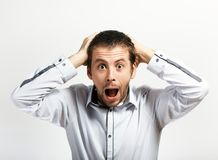 Scared and surprised man. Looking at camera yelling royalty free stock image