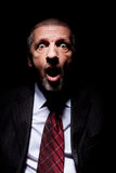 Scared man in business suit Royalty Free Stock Photos