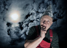 Scared suspecting man waiting for aliens royalty free stock image