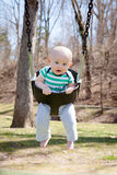 Scared Swinging  Baby Stock Image