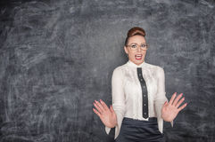 Scared teacher in the eyeglasses Royalty Free Stock Photography