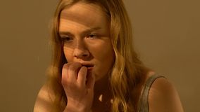 Scared teen girl biting nails, violence and assault victim, social insecurity. Stock footage stock footage