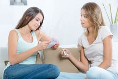 Scared teen holding pregnancy test with best friend royalty free stock photos