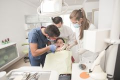 Boy with perfect teeth scared at the dentist. Scared teenager boy is having a check up at the dentist Stock Image