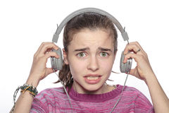 Scared teenager girl with headphones Stock Photo
