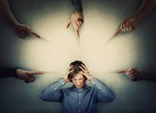 Free Scared Teenager Panic Under Pressure, Hands To Head, Eyes Closed Feeling Discomfort And Emotional Stress As A Lot Of Hands Fingers Stock Photo - 160529650