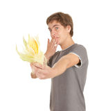 Scared teenager with raw corn, maize. Scared young man with raw corn, maize Stock Photo