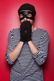 Scared thief wants your money. Stock Photography