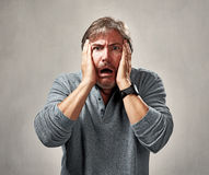 Scared threatened man. Afraid threatened mature caucasian man face expressions royalty free stock images