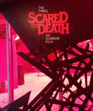 Scared To Death sign at MoPOP in Seattle. Scared To Death: The Thrill of Horror Film exhibit sign at Museum of Pop Culture MoPOP in Seattle royalty free stock photos