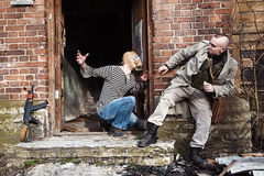 Scared to death skinhead in the stairs of the ruined house Stock Images