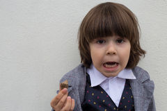 Scared toddler boy with snail Royalty Free Stock Photo