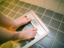 Scared on weight scale Stock Image