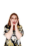 Scared woman. A very scared woman holding her hands on her checks and her mouth Royalty Free Stock Photo
