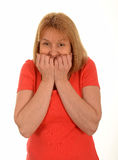 Scared woman. Holding hands to her mouth, white studio background Stock Photography