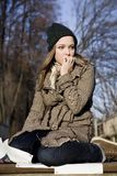 A Scared Woman. In winter clothing outdoors royalty free stock images