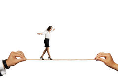 Scared woman balancing on the rope Stock Images