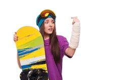 Scared woman with broken arm and snowboard Royalty Free Stock Photography