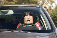 Scared woman in a car. Scared young woman in a car royalty free stock photography