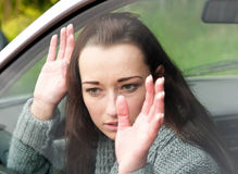 Scared woman in the car Royalty Free Stock Images