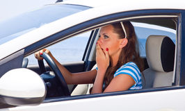 A scared woman is in the car Royalty Free Stock Images