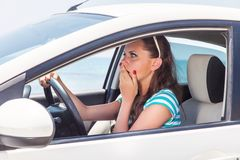 A scared woman is in the car Stock Photos