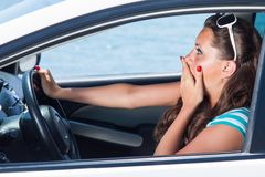 A scared woman is in the car Royalty Free Stock Photography
