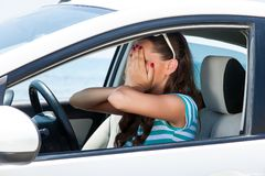 A scared woman is in the car Stock Photo