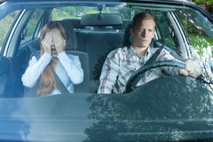 Scared woman in a car Stock Images