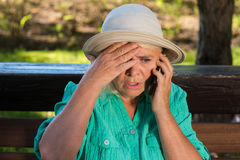 Scared woman with cell phone. Royalty Free Stock Image
