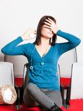 Scared woman covering eyes with hand Royalty Free Stock Images