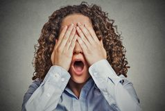 Scared woman covering eyes wide open mouth Royalty Free Stock Photos