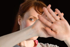Scared woman covering her face Royalty Free Stock Photos