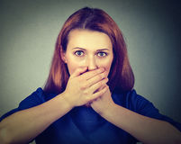 Scared woman covering her mouth with hands Stock Image