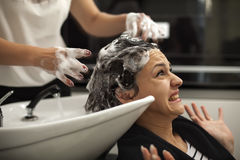 Scared woman in a hair salon Royalty Free Stock Photography