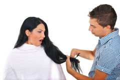 Scared woman and hairstylist at hair salon Stock Photos