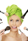Scared woman has brushes around face. Royalty Free Stock Photo