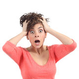 Scared woman with her hands on the head and opened mouth royalty free stock image